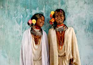 Two tribal ladies stand tall together